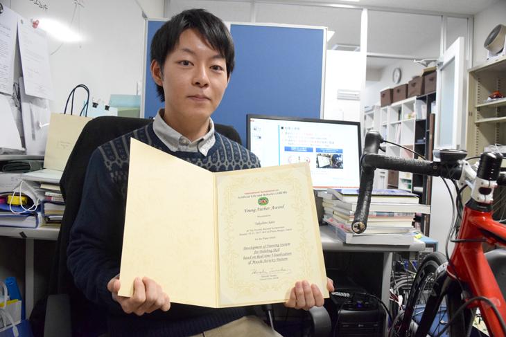 「国際人工生命ロボットシンポジウム AROB 22nd 2017」管理工学専攻2年生 佐藤 拓広さんYoung Author Award受賞